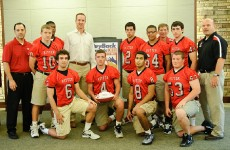 Peyton Manning with members of the Ritter High School football team who will be participating in the 2012 PeyBack Classic.  Photo Courtesy of Maya Laurent.