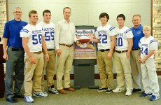 Peyton Manning with members of the Heritage Christian Football team who will be participating in the 2012 PeyBack Classic.  Photo Courtesy of Maya Laurent.